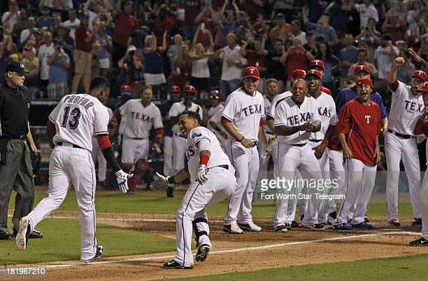 The Texas Rangers' Jurickson Profar is met by teammates on the third base line after Profar's ninthinning walkoff home run against the Los Angeles...