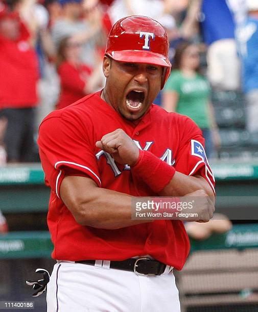 The Texas Rangers' Nelson Cruz celebrates at home plate after scoring in the eighth inning on a tworun base hit by David Muphy against the Boston Red...