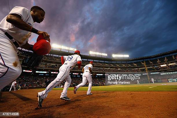 The Texas Rangers run on to the field before the fifth inning against the Kansas City Royals at Globe Life Park in Arlington on May 13 2015 in...