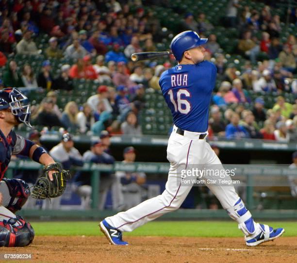 The Texas Rangers' Ryan Rua hits a grand slam during the eighth inning against the Minnesota Twins at Globe Life Park in Arlington, Texas, on...