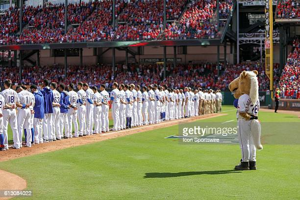 The Texas Rangers stand for the National Anthem prior to game 1 of the ALDS between the Toronto Blue Jays and Texas Rangers at Globe Life Park in...