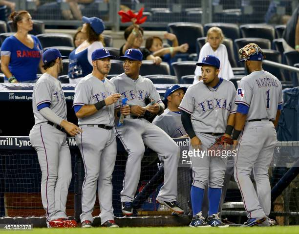 The Texas Rangers wait as the umpire and managers discuss the weather during a rain delay on July 23 2014 at Yankee Stadium in the Bronx borough of...