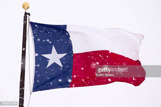 The Texas state flag is battered by high wind and heavy snow on December 27 2015 in Lubbock Texas Coming on the heels of several strong tornadoes...