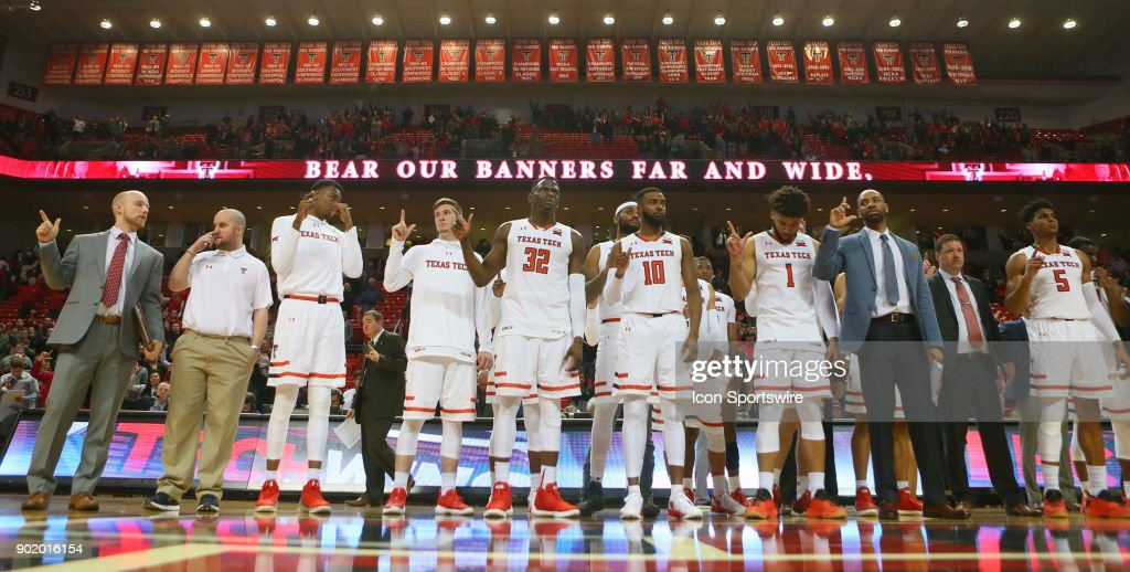 The Texas Tech players and coaches stand for the school song after the Texas Tech Raider's 74-58 victory over the Kansas State Wildcats on January 6, 2018 at United Supermarkets Arena in Lubbock, TX.