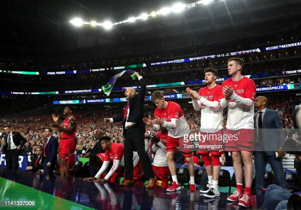 The Texas Tech Red Raiders bench reacts to the play against the Virginia Cavaliers in the first half during the 2019 NCAA men's Final Four National...