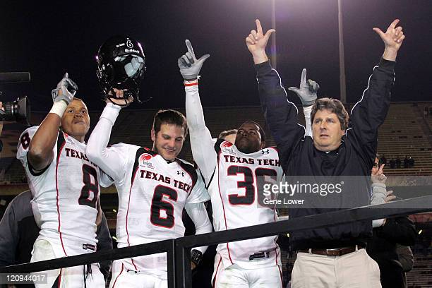 The Texas Tech Red Raiders celebrate a big win against the Minnesotta Golden Gophers after the Insight Bowl at Sun Devil Stadium in Tempe AZ on...