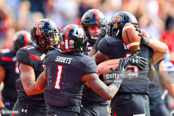 The Texas Tech Red Raiders celebrate a touchdown during the game against the Kansas State Wildcats on November 4, 2017 at Jones AT&T Stadium in...