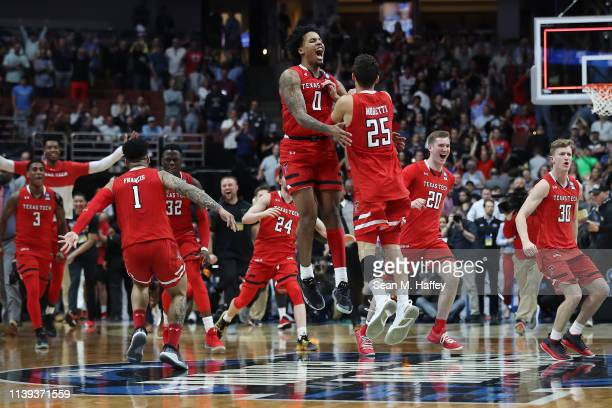 The Texas Tech Red Raiders celebrate their victory against the Gonzaga Bulldogs during the 2019 NCAA Men's Basketball Tournament West Regional at...