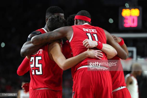 The Texas Tech Red Raiders huddle in the first half against the Virginia Cavaliers during the 2019 NCAA men's Final Four National Championship game...