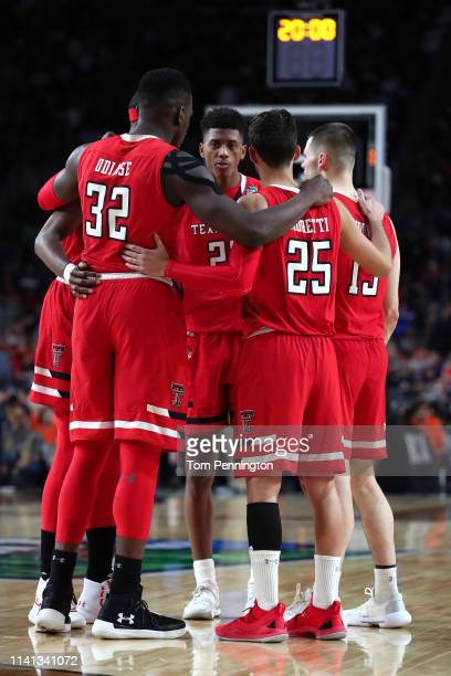 The Texas Tech Red Raiders huddle prior to the second half against the Virginia Cavaliers during the 2019 NCAA men's Final Four National Championship...