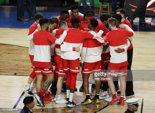 The Texas Tech Red Raiders huddle together before the game against the Virginia Cavaliers in the 2019 NCAA men's Final Four National Championship...
