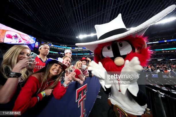 The Texas Tech Red Raiders mascot poses for a photo with fans prior to the 2019 NCAA men's Final Four National Championship game between the Virginia...