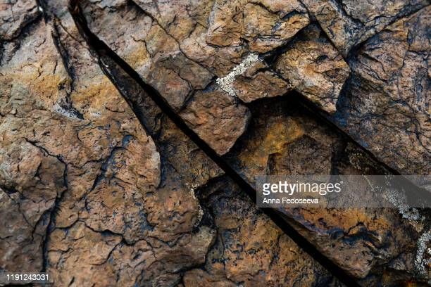 the texture of brown stone with blue veins. stone with a crack. background for design and decoration. - planet earth stock pictures, royalty-free photos & images