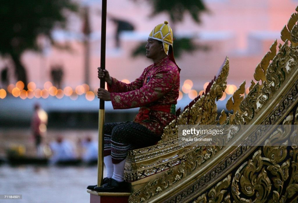 The Thai Royal Barge procession cruises down the Chao Praya river during the 60th anniversary celebrations of Thailand King Bhumibol Adulyadej accession to the throne on June 12, 2006 in Bangkok, Thailand. The Royal barges are an ancient Thai tradition displayed for the foreign monarchs who have come to join the celebrations.