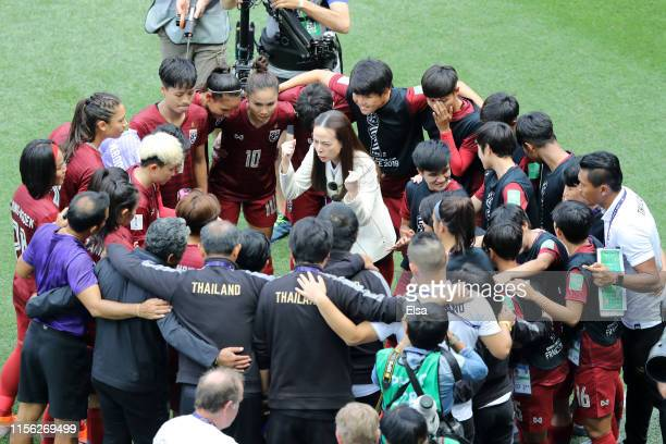 The Thailand players and staff form a team huddle prior to the 2019 FIFA Women's World Cup France group F match between Sweden and Thailand at Stade...