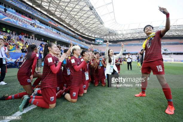 The Thailand players take a selfie after the 2019 FIFA Women's World Cup France group F match between Sweden and Thailand at Stade de Nice on June...