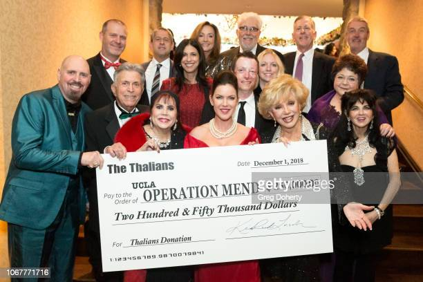 The Thalians Board Members display the donatoin check at The Thalians Holiday Party at Bel Air Country Club on December 1 2018 in Los Angeles...