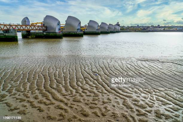 the thames flood barrier on the thames river london uk - extreme weather stock pictures, royalty-free photos & images