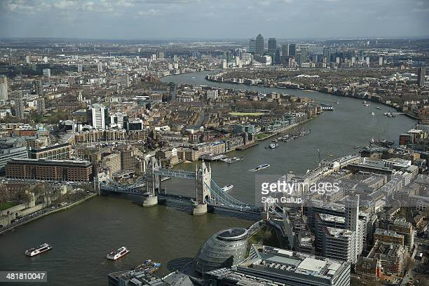 The Thames River snakes through the city center past Tower Bridge in this aerial view taken from the London Shard on March 21 2014 in London United...