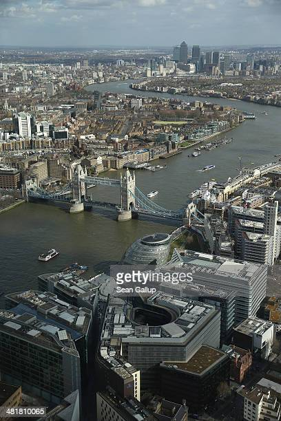 The Thames River snakes through the city center past Tower Bridge in this aerial view taken from The Shard on March 21 2014 in London United Kingdom...