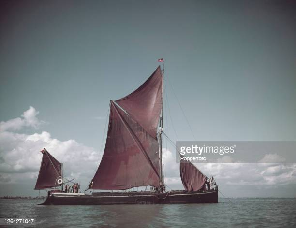 The Thames sailing barge 'Arrow', spritsail rigged with two masts and mizzen, topsail, mainsail and foresail visible, sailing in the Thames estuary...