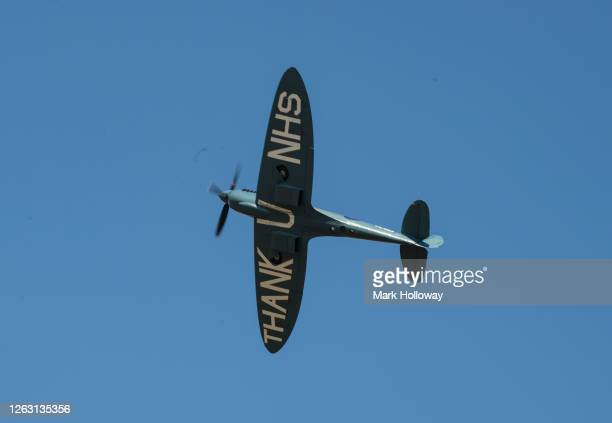 The 'Thank U NHS' Spitfire flys over Goodwood Airfield at Goodwood on August 01 2020 in Chichester England The 'Thank U NHS' Spitfire will take to...