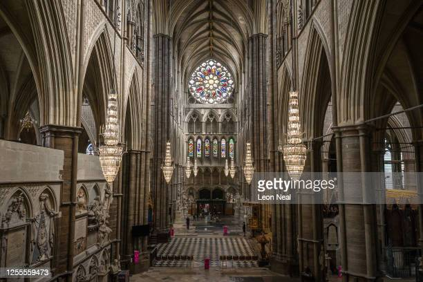 The the first visitors to pass through the doors at Westminster Abbey are seen as it re-opens to the public, on July 11, 2020 in London, England....
