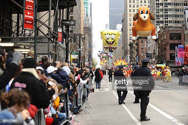 The The Giant Texas Hot Dog and SpongeBob Squarepants balloons hover over the crowd during the 83rd annual Macy's Thanksgiving Day parade on the...