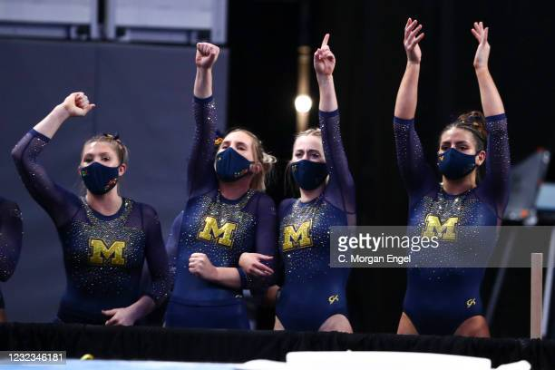 The the Michigan Wolverines cheer on their teammates competing in the vault during the Division I Womens Gymnastics Championship held at Dickies...