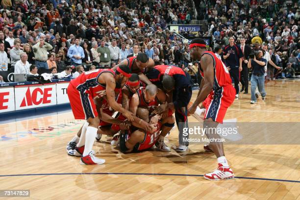 The the New Jersey Nets pile on Vince Carter after hitting the game winner against the Utah Jazz on January 29 2007 at the EnergySolutions Arena in...