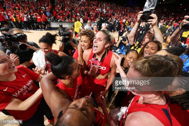 The the Washington Mystics celebrate after a win against the Connecticut Sun during Game Five of the 2019 WNBA Finals on October 10 2019 at St...