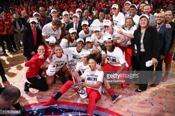The the Washington Mystics pose for a photo with the WNBA Championship Trophy afterGame Five of the 2019 WNBA Finals on October 10 2019 at St...