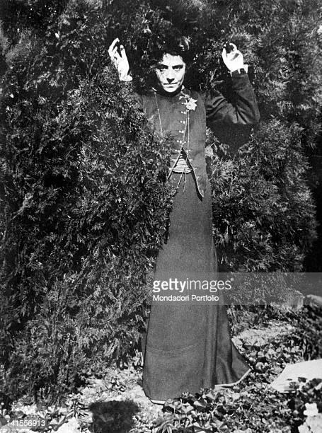 The theatre actress Eleonora Duse posing for Gabriele D'Annunzio in the gardens of the villa Capponcina Settignano 1889