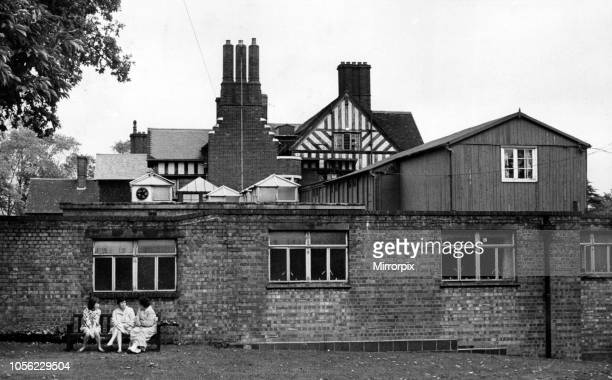 The thee generations of building work at Keresley Hospital are summed up in this picture the original pseudoTudor house the flatroofed sheltertype...