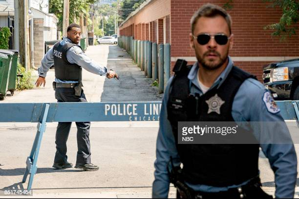 D 'The Thing About Heroes' Episode 503 Pictured LaRoyce Hawkins as Kevin Atwater Patrick John Flueger as Adam Ruzek
