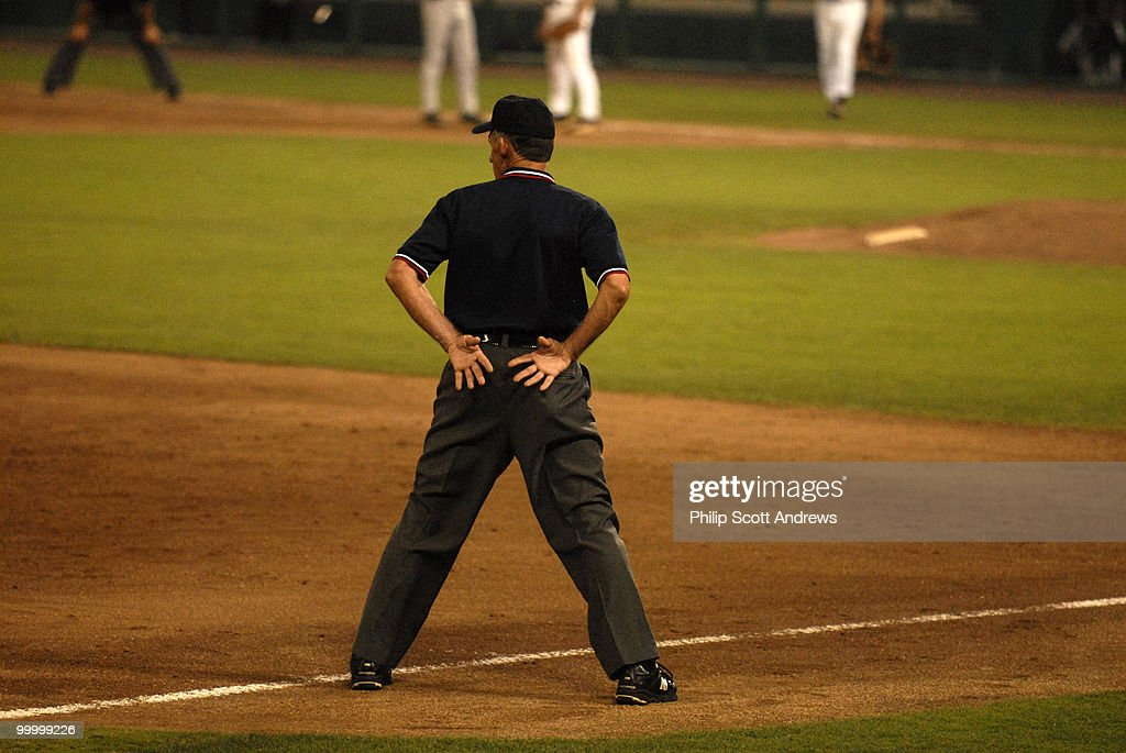 The Third Base Umpire keeps an eye on the game.