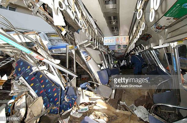 The third carriage of the crushed commuter train after it derailed and plunged into an apartment building on April 25 2005 in Amagasaki Hyogo Japan...
