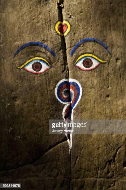 The third (seeing) eye painted on a sacred stone, Swayambunath (Monkey Temple), Kathmandu, Nepal