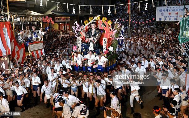 The third float 'NakasuNagare' rushes through Seido Street of Kushida Jinja Shrine during the Hakata Gion Yamakasa festival on July 15 2015 in...
