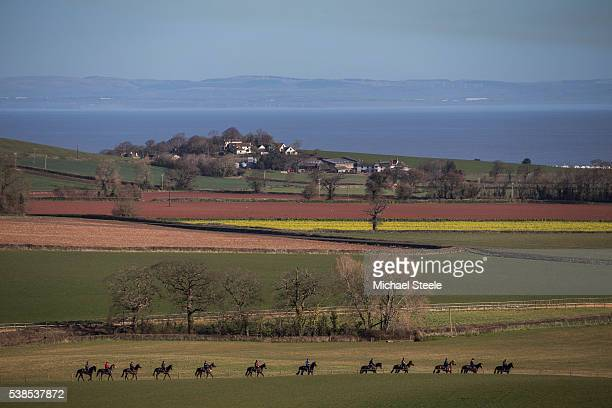 The third lot head out onto the grass track at Sandhill Racing Stables on March 31 2016 in Minehead England Sandhill Racing Stables set in 500...