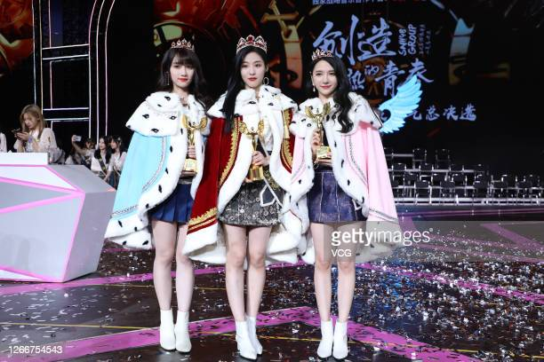 The third place Song Xinran, the first place Sun Rui and the second place Lu Ting perform during the SHN48 Group 7th General Election Concert on...