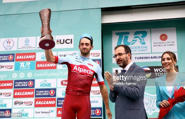 The third place winner Australian Nathan Haas who rides for the Team Katusha Alpecin and Turkey's Youth and Sports Minister Mehmet Muharrem Kasapoglu...