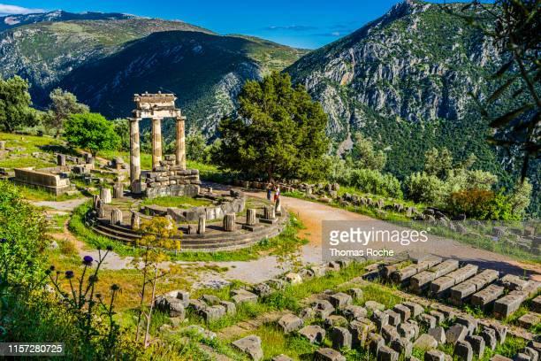 the tholos of delphi - archäologie stock-fotos und bilder