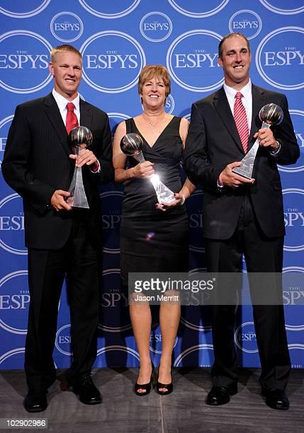 The Thomas family Aaron Thomas Jan Thomas and Todd Thomas recipients of the Arthur Ashe Courage Award pose in press room during the 2010 ESPY Awards...