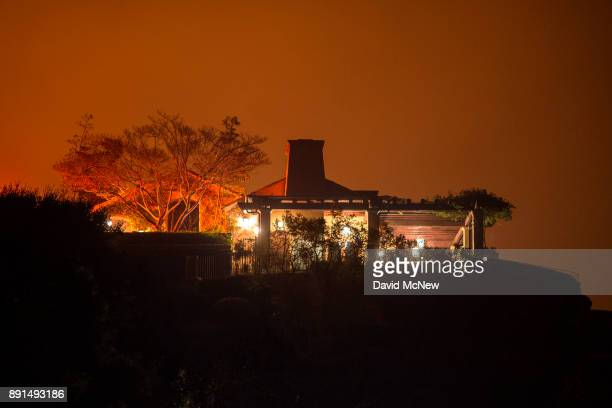 The Thomas Fire approaches a home on December 12 2017 in Montecito California The Thomas Fire has spread across 365 miles so far and destroyed about...