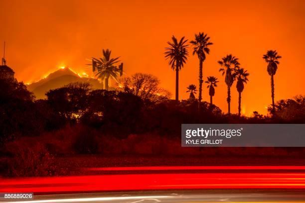 TOPSHOT The Thomas Fire burns along a hillside near Santa Paula California on December 5 2017 More than a thousand firefighters were struggling to...