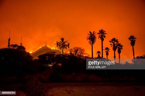 The Thomas Fire burns along a hillside near Santa Paula California on December 5 2017 More than a thousand firefighters were struggling to contain a...