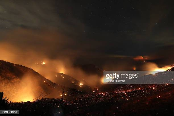 The Thomas fire burns in the Los Padres National Forest on December 8 2017 near Ojai California The Thomas fire has burned over 132000 acres and has...