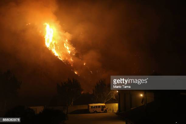 The Thomas Fire burns near a school bus on December 7 2017 in Ventura California The fire has destroyed 439 structures and burned 115000 acres