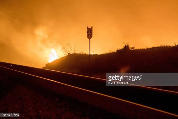 The Thomas Fire burns past the 101 Highway towards the Pacific Coast Highway in Ventura California December 7 2017 Local emergency officials warned...
